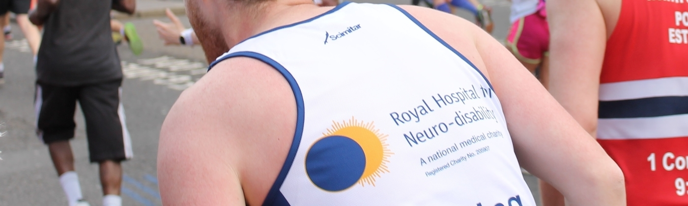 Fundraise for the RHN by running the London Marathon, like this runner.