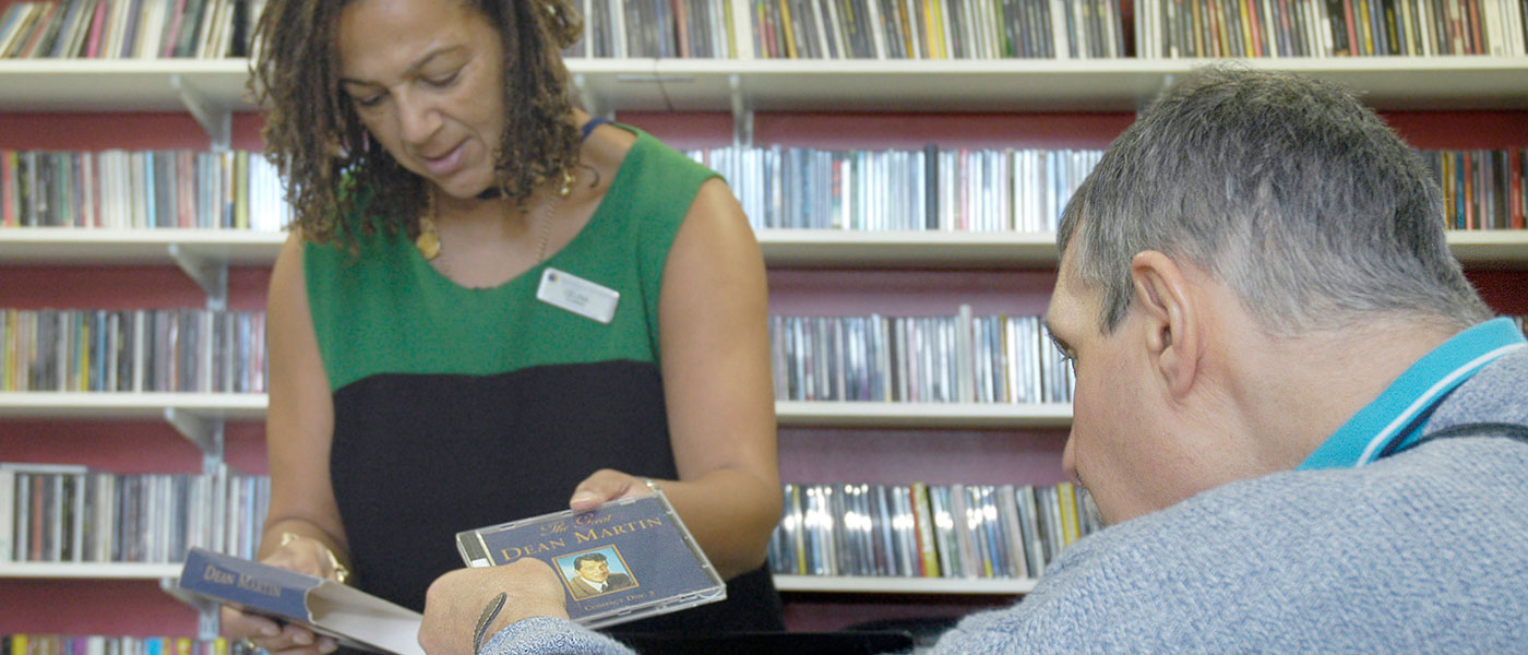 A resident borrows a CD from the Wenham Music Library