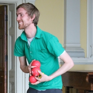 A volunteer carrying boccia balls at the Royal Hospital for Neuro-disability