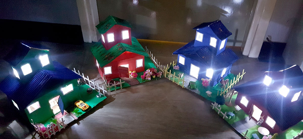 cardboard houses lit by battery