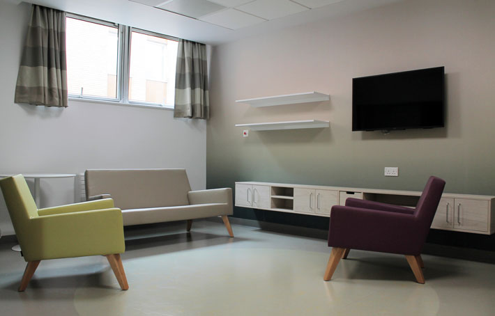 A modern communal room for patients in a hospital