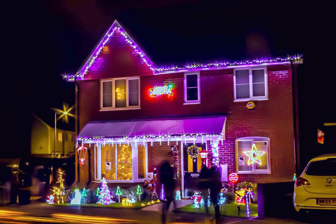 English house with outdoor Christmas light display