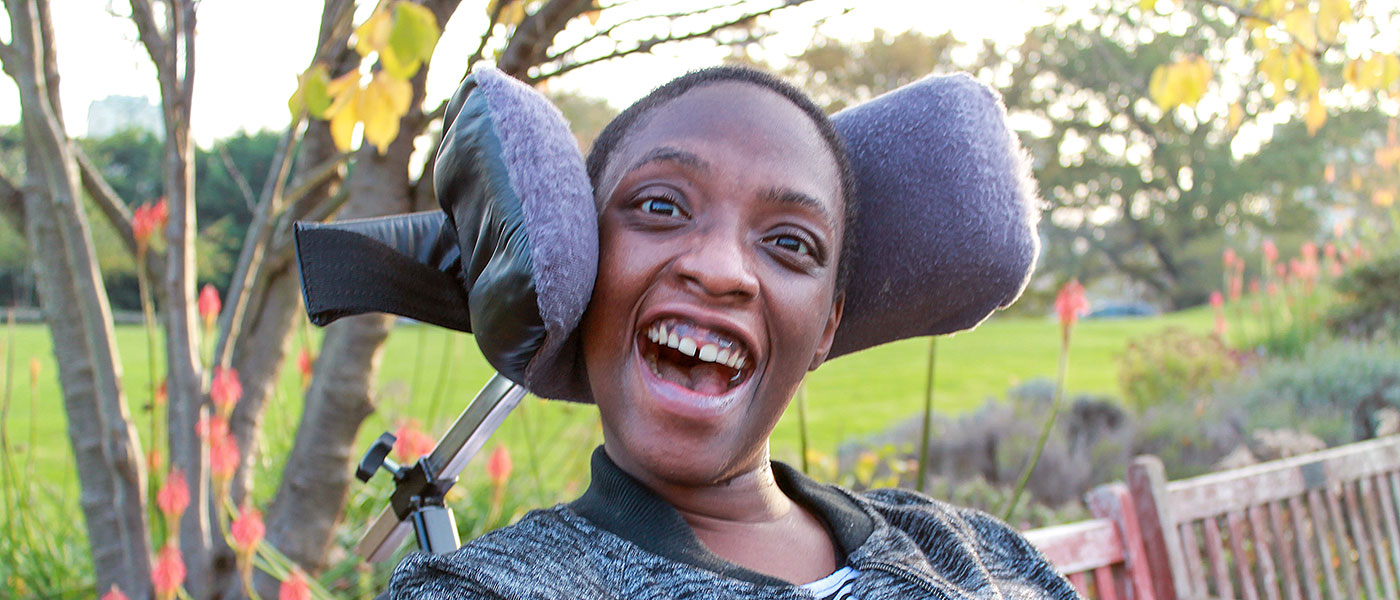smiling black woman in wheelchair